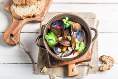 Mussels with garlic sauce served with bread Royalty Free Stock Image