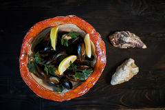 Mussels on ice ready to cook with lemon and white wine jpg Stock Photo