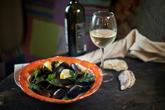 Mussels on ice ready to cook with lemon and white wine jpg stock photos