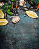 Mussels with lemon and ingredients for cooking , top view, place for text. Seafood concept Stock Image