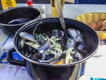Mussels for lunch. Mussels in white wine with crusty bread royalty free stock image