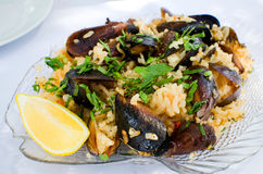 Mussels with rice. Bulgarian cuisine: Burgas style mussels (mussels with rice, herbs and wine royalty free stock photo
