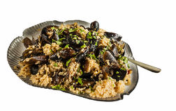 Mussels with rice on the plate Stock Photography