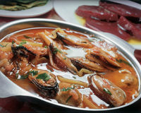 Mussels saganaki. Royalty Free Stock Images