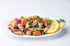 Mussels salad with onion and lemon. Close up. Stock Photography