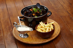 Mussels with sauce Royalty Free Stock Photos