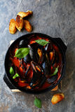 Mussels with sauce in pan Royalty Free Stock Photo