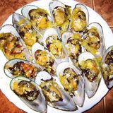 Mussels in shell backed with cheese and garlic Royalty Free Stock Photo