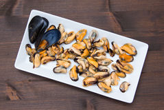 Mussels without shells on wooden tray on top stock photos