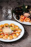 Mussels and shrimps on stone table. royalty free stock image
