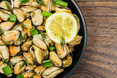 Mussels in a simple rustic table. Royalty Free Stock Image