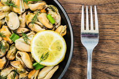 Mussels in a simple rustic table. Royalty Free Stock Images