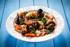 Mussels soup Stock Images