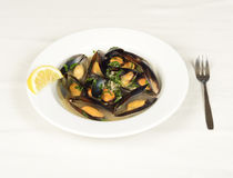 Mussels soup with a piece of lemon. Stock Photo