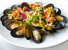 Mussels with vinaigrette peppers. Royalty Free Stock Photo