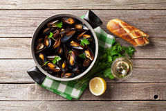 Mussels and white wine Stock Photos