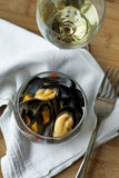 Mussels and wine on a table Royalty Free Stock Images