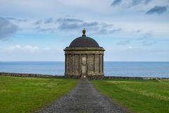 Mussenden Temple, Northern Ireland. Mussenden Temple, located in the beautiful surroundings of Downhill Demesne near Castlerock in County Londonderry, Northern royalty free stock image