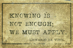 Must apply DaVinci. Knowing is not enough; we must apply - ancient Italian artist Leonardo da Vinci quote printed on grunge vintage cardboard Stock Photography