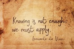 We must apply Leonardo. Knowing is not enough; we must apply - ancient Italian artist Leonardo da Vinci quote printed on vintage grunge paper stock photo