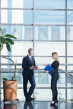 We must discuss our business offer. Man and women working in corporation, talking in the workplace Stock Photos