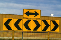 Must Turn at Intersection Signs. Arrows and chevrons to inform motorists that they must turn either left or right Stock Images