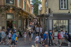 Tourist in alley of artists in old Quebec Stock Image