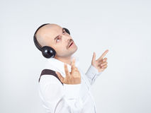 Mustache businessman listening to music on headphones and sings Royalty Free Stock Photography