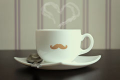 Mustache cup with steam in heart shape Stock Photos