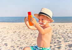 The mustache drawing sunscreen on baby (boy) face.