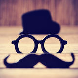 Mustache, eyeglasses and hat forming the face of a man Royalty Free Stock Images