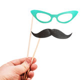 Mustache and glasses of paper in his hand Royalty Free Stock Photos
