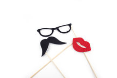 Mustache, glasses, sponge on a stick Stock Photos