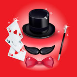 Mustache with hat and with red bow tie and magic wand. On red background Stock Photos