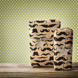 Mustache pattered gift boxes with star shaped tags Stock Photography