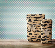 Mustache pattered gift boxes with star shaped tags Royalty Free Stock Photography