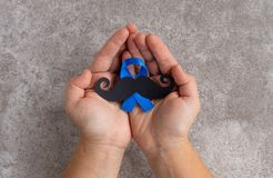 Mustache pattern with blue ribbon symbol. November movember concept. stock image