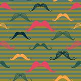 Mustache seamless pattern in vintage style. Pattern or texture with curly retro gentleman mustaches on striped background. Used for hipster websites, desktop Stock Image