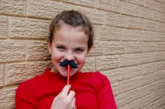 Mustache smiling girl Royalty Free Stock Photos