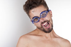 Mustached man with glasses for swimming. Beautiful unshaven man with a twisted mouth with glasses for swimming royalty free stock photos