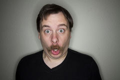 Mustached man making a funny face Stock Images