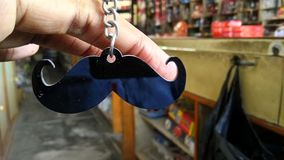 Mustaches. Key ring stock image