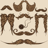 Mustaches. Set of hand drawn brown patterned mustaches Royalty Free Stock Photography