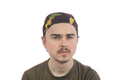 Mustachioed young bearded man in a bandana. Isolated Royalty Free Stock Photos