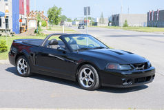 Ford Mustang cobra. Picture of the 2004 Ford Mustang cobra convertible in black color in the parking stock photos