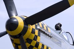 Mustang Flying Ace. A pilot's leather flying helmets sits atop the cockpit of a P-51 Mustang fighter plane stock images