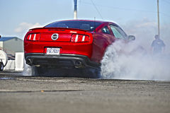 Smoke show. Napierville dragway, canada - june 7, 2014 picture of 2013 mustang gt during smoke show at the starting line at head up challenge event Royalty Free Stock Photos