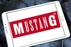 Mustang Jeans logo. Logo of Mustang Jeans company on samsung tablet. Mustang is one of the most popular trademarks all over the world and biggest manufacturer of Royalty Free Stock Photos