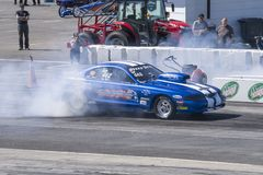 Mustang making a smoke show on the track Stock Images