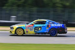 Mustang 302 race car. Ford Mustang Boss 302R races at the pro racing venue royalty free stock photography